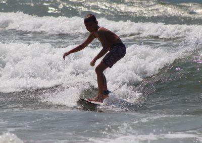 boy-surfing-lesson-wave